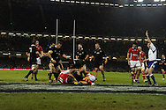 New Zealand's players celebrate as Tony Woodcock (on ground) scores their 2nd try. Dove Men autumn international series, Wales v New Zealand at the Millennium stadium in Cardiff , South Wales on Saturday 24th November 2012. pic by Andrew Orchard, Andrew Orchard sports photography,