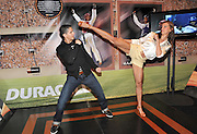 "Taekwondo champions Diana Lopez and Mark Lopez demonstrate some moves at the ""Rely on Copper to Go for the Gold"" launch event, Wednesday, March 21, 2012, in New York, where Duracell announced its athlete partnerships with Olympians Dwight Howard, Hunter Kemper, Diana and Mark Lopez, and Summer Sanders. (Diane Bondareff/Insider Images for Duracell)"