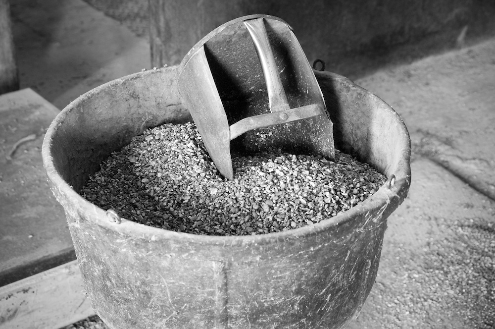 Feed scoop in feed box at a Mill