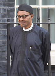 © Licensed to London News Pictures. 23/05/2015. London, UK. President of Nigeria, General Muhammadu Buhari, leaves 10 Downing Street, central London, after a meeting with British Prime Minister David Cameron. Photo credit : Isabel Infantes/LNP
