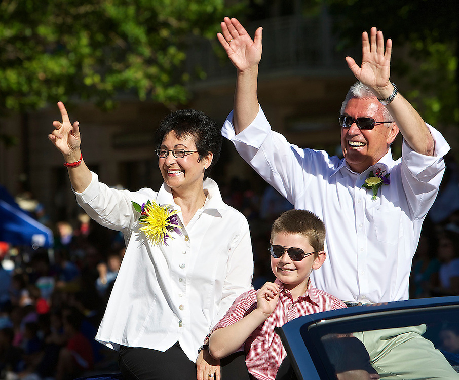 President Dieter F. Uchtdorf Second Counselor in the First Presidency of The Church of Jesus Christ of Latter-day Saints, right and his wife Harriet and their grandson Eric wave to the crowds gathered to watch the Days of '47 Parade in Salt Lake City, Utah, Saturday, July 24, 2010. August Miller, Deseret News .
