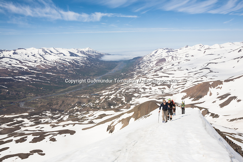 Skiers ascending mt. 1124m. Flateyjardalur, Iceland.