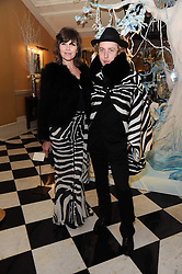 JESSIE MORRIS and JAMES BROWN at the launch of the Claridge's Christmas Tree designed by John Galliano for Dior held at Claridge's, Brook Street, London on 1st December 2009.