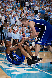 CHAPEL HILL, NC - MARCH 05: Miles Plumlee #21 of the Duke Blue Devils helps up teammate Nolan Smith #2 while playing the North Carolina Tar Heels on March 05, 2011 at the Dean E. Smith Center in Chapel Hill, North Carolina. North Carolina won 67-81. (Photo by Peyton Williams/UNC/Getty Images) *** Local Caption *** Miles Plumlee;Nolan Smith