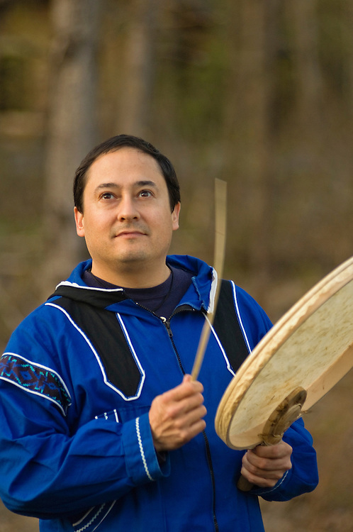 Loren Anderson, a native Alaskan of the Alutiiq culture from Kodiak Island, playing a Cauyaq drum (skin is made from walrus stomach) at the Alaska Native Heritage Center in Anchorage, Alaska.