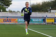 AFC Wimbledon goalkeeper Matthew (Matt) Cox warming up during the EFL Trophy (Leasing.com) match between AFC Wimbledon and U23 Brighton and Hove Albion at the Cherry Red Records Stadium, Kingston, England on 3 September 2019.