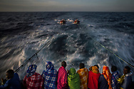 Refugees and migrants from different African nationalities and Bangladeshis, rest aboard Golfo Azurro, the Spanish NGO Proactiva Open Arms rescue ship, as the vessel heads to the italian island of Lampedus, after being rescued off the Libyan coast when they were trying to reach Europe, early Sunday, March 5, 2017. (© Santi Palacios)