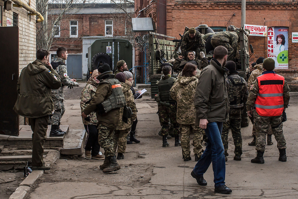ARTEMIVSK, UKRAINE - FEBRUARY 15: A Ukrainian fighter injured in the heavily contested town of Debaltseve is unloaded from a truck at a hospital after being evacuated from the field on February 15, 2015 in Artemivsk, Ukraine. A ceasefire scheduled to go into effect at midnight was reportedly observed along most of the front, though fighting in Debaltseve continued with Ukrainian forces there effectively surrounded. (Photo by Brendan Hoffman/Getty Images) *** Local Caption ***