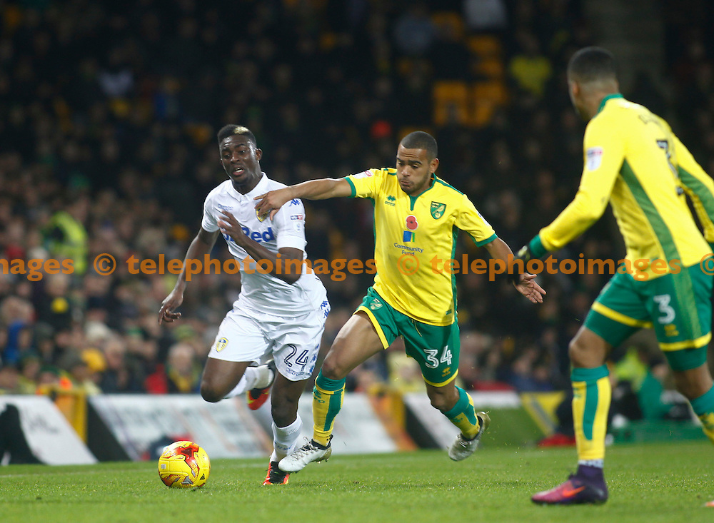 Leeds United's Hadi Sacko and Norwich City's Louis Thompson during the Sky Bet Championship match between Norwich City and Leeds United at Carrow Road in Norwich. December 5, 2016.<br /> John Marsh / Telephoto Images<br /> +44 7967 642437