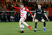Alfie May of Doncaster Rovers shoots during the EFL Sky Bet League 1 match between Doncaster Rovers and Barnsley at the Keepmoat Stadium, Doncaster, England on 15 March 2019.
