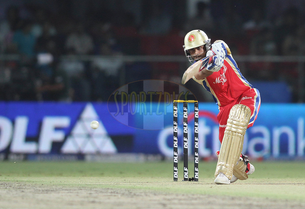 Virat Kohli of the Royal Challengers Bangalore drives a delivery through the covers during match 30 of the Indian Premier League ( IPL ) Season 4 between the Delhi Daredevils and the Royal Challengers Bangalore held at the Feroz Shah Kotla Stadium in Delhi, India on the 26th April 2011..Photo by Shaun Roy/BCCI/SPORTZPICS