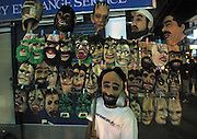 A local vendor sells scary masks from his mobile stall in Chawang beach, Koh Samui, Thailand.