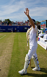 LIVERPOOL, ENGLAND - Sunday, June 22, 2014: Australian tennis legend Peter McNamara walks onto court in full cricket whites during Day Four of the Liverpool Hope University International Tennis Tournament at Liverpool Cricket Club. (Pic by David Rawcliffe/Propaganda)
