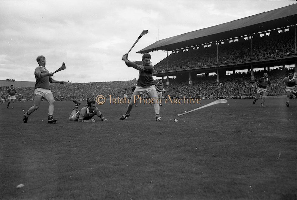 01/09/1968<br /> 09/01/1968<br /> 1 September 1968<br /> All-Ireland Senior Hurling Final: Tipperary v Wexford at Croke Park, Dublin. <br /> S. McLoughlin (Tipperary) gets ready to shoot at the Wexford goal after getting possession of the bal from two Wexford backs, T. Neville (on the ground) and E. Kelly.