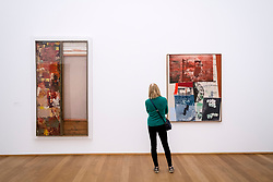 Woman looking at paintings by Robert Rauschenberg at Hamburger Bahnhof modern art museum in Berlin, Germany