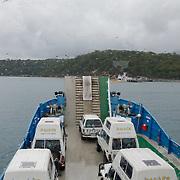 Frazer Island, on the east coast of Australia, is a sand island. 4WD aboard the ferry to Fraser Island.