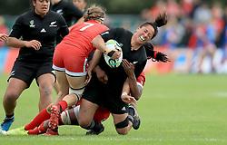 Canada's Karen Paquin and Latoya Blackwood (right) and New Zealand's Aroha Savage