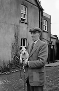 "Harry Walker, Kennelman, Westmeath Hounds, Mullingar.1962..05.02.1962..02.05.1962..5th February 1962..Picture shows noted kennelman Mr Harry Walker at his home at The Kennels, Knockdrin, Mullingar ,Co WestMeath. he is holding his own pet ""Judy""."