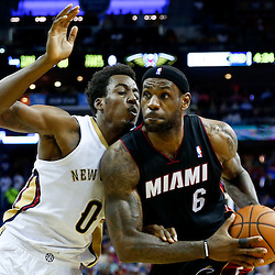 Mar 22, 2014; New Orleans, LA, USA; Miami Heat forward LeBron James (6) drives past New Orleans Pelicans forward Al-Farouq Aminu (0) during the second half of a game at the Smoothie King Center. The Pelicans defeated the Heat 105-95. Mandatory Credit: Derick E. Hingle-USA TODAY Sports