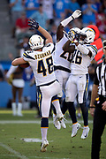 Los Angeles Chargers linebacker Nick Dzubnar (48) leaps and celebrates with Los Angeles Chargers defensive back Casey Hayward Jr. (26) and Los Angeles Chargers defensive back Desmond King II (20) after Dzubnar recovers an apparent fumble on a fourth quarter kick return subsequently ruled out of bounds and not a turnover during the NFL week 4 regular season football game against the San Francisco 49ers on Sunday, Sept. 30, 2018 in Carson, Calif. The Chargers won the game 29-27. (©Paul Anthony Spinelli)