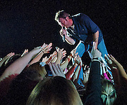 SINGING FOR HIS FANS--Country singing sensation Blake Shelton leans into the concert crowd with another hit as the fans reach for the star during a special Ft. Meade performance Friday night.