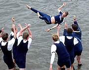 THE VICTORIOUS OXFORD ROWING CREW THROW COX JAMES OMARTIAN INTO THE RIVER THAMES AFTER BEATING CAMBRIDGE BY THE SHORTEST DISTANCE IN HISTORY A FOOT IN THE 149TH BOAT RACE.6.4.03.PIX STEVE BUTLER