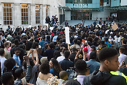 London, July 8th 2016. Hundreds gather on London's Southbank before marching through the streets of London to Parliament Square, Downing Street and the BBC, in a Black Lives Matter protest in solidarity with Americans following the shooting dead of two black men, Philando Castile in Minnesota and Alton Sterling in Louisiana by police in the US. PICTURED: The crowd chants outside the BBC demanding greater coverage of police shootings and brutality in the US.