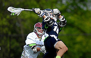 7 MAY 2009 -- CREVE COEUR, Mo. -- St. Louis University High School lacrosse player Michael Leritz (10) launches a shot over pressure from DeSmet Jesuit High School's Brendan Besancenez (3) during second half of the 7th annual Father Marco Cup at DeSmet in Creve Coeur, Mo. Saturday, May 7, 2011. SLUH topped DeSmet 13-10 in the annual game. Image © copyright 2011 Sid Hastings.