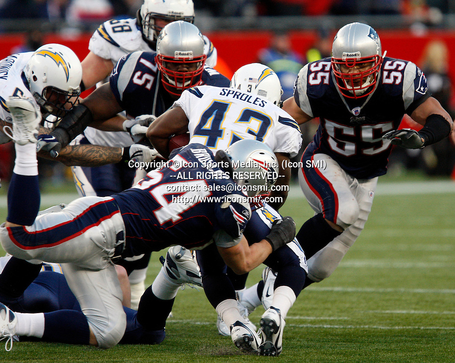 20 January 2008: New England Patriots linebacker Tedy Bruschi (54), defensive tackle Vince Wilfork (75) and linebacker Junior Seau (55) work to bring down San Diego Chargers running back Darren Sproles (43) during the NFL AFC Championship football game won by the Patriots 21-12 in Foxborough, MA, January 20, 2008. The Patriots will play the New York Giants in the Super Bow on February 3, 2008 in Arizona.