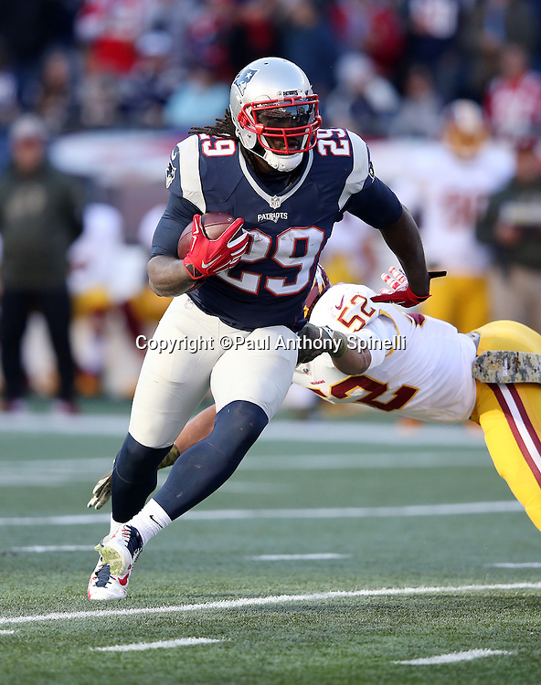 New England Patriots running back LeGarrette Blount (29) pushes off a tackle attempt by Washington Redskins inside linebacker Keenan Robinson (52) as he runs the ball for a third quarter gain of 3 yards during the 2015 week 9 regular season NFL football game against the Washington Redskins on Sunday, Nov. 8, 2015 in Foxborough, Mass. The Patriots won the game 27-10. (©Paul Anthony Spinelli)
