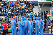 Fans celebrate as India take their first wicket during the ICC Cricket World Cup 2019 match between South Africa and India at the Hampshire Bowl, Southampton, United Kingdom on 5 June 2019.