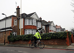 © Licensed to London News Pictures. 19/12/2011, London, UK. A police community support officer cycles past the embassy . The North Korean embassy in West London. Kim Jong Il's death on Saturday, aged 69, was announced last night in a special broadcast by state TV from the North Korean capital. Photo credit: Stephen Simpson/LNP