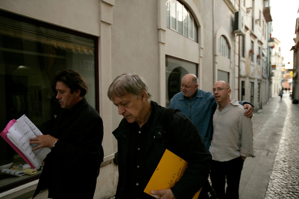 "French clarinetists Louis Sclavis and Michel Portal (who also plays bandoneon), swiss drummer Daniel Humair and bass player Sebastien Boisseau walking on Coimbra's streets. ""Jazz ao Centro"" jazz festival is held twice a year in portuguese town of Coimbra."