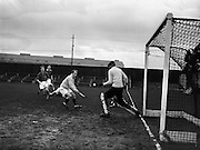 16/01/1960<br /> 01/16/1960<br /> 16 January 1960<br /> Interprovincial Mens Hockey: Munster v Leinster. Munster goalie D. O'Riain, (right) clears in front of the goalmouth; Munster full back P. Keane is second from right, during the Senior Mens Interprovincial at Londonbridge Road, Dublin.