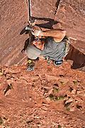 "Chris Kalous laughing his way up  ""Not That Funny,""  5.12, Indian Creek Canyon, Southern Utah."