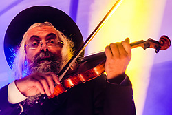 Trafalgar Square, London, December 16th 2014.  London's Jewish community celebrates Chanukah in the Square which marks the beginning of the Jewish festival of lights. The annual event is presented by the Jewish Leadership Council, London Jewish Forum and Chabad and is supported by the Mayor of London.  PICTURED: Violinist  Daniel Ahaviel entertains the crowds in Trafalgar Square.