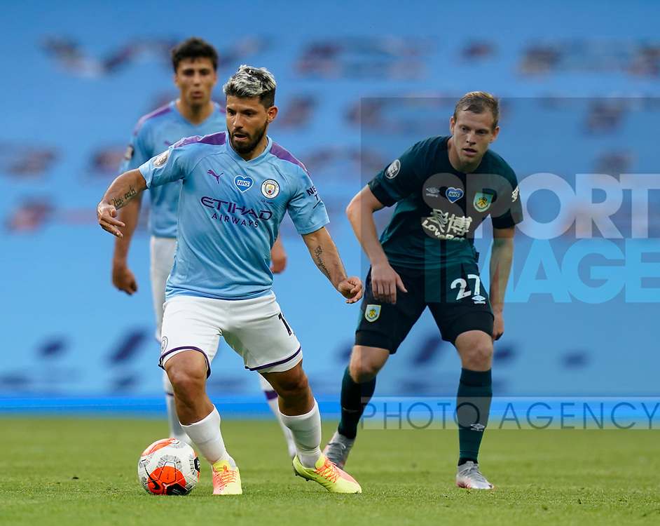Sergio Aguero of Manchester City collects the ball in front of Matej Vydra of Burnleyduring the Premier League match at the Etihad Stadium, Manchester. Picture date: 22nd February 2020. Picture credit should read: Andrew Yates/Sportimage
