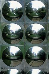 Wall clad with reflective aluminium disks. Design Diarmuid Gavin