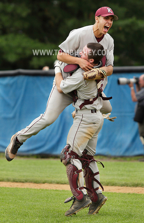 Kingston pitcher Sam Einhorn, left, celebrates with catcher Jake Ryan after Kingston defeated Pine Bush 2-1 in the Section 9 Class AA baseball championship game at SUNY New Paltz on Friday June 1, 2012.