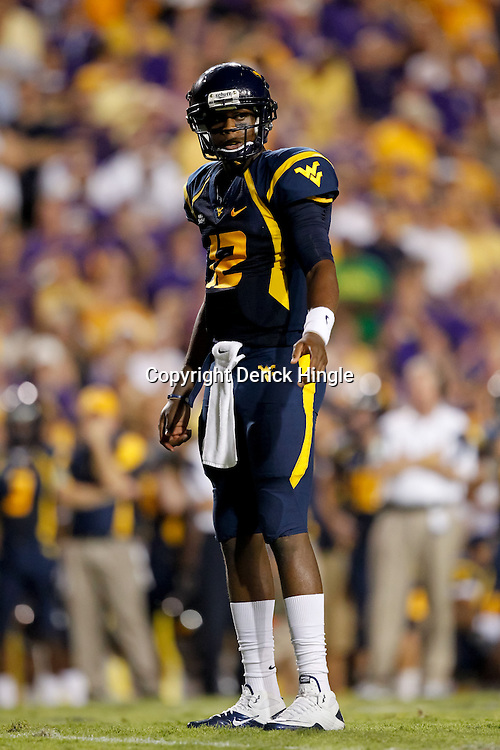 Sep 25, 2010; Baton Rouge, LA, USA; West Virginia Mountaineers quarterback Geno Smith (12) on the field against the LSU Tigers during the first half at Tiger Stadium.  Mandatory Credit: Derick E. Hingle