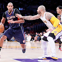 15 March 2015: Atlanta Hawks center Al Horford (15) drives past Los Angeles Lakers forward Carlos Boozer (5) and Los Angeles Lakers guard Jordan Clarkson (6) during the Atlanta Hawks 91-86 victory over the Los Angeles Lakers, at the Staples Center, Los Angeles, California, USA.