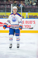 PENTICTON, CANADA - SEPTEMBER 16: Thomas Foster #64 of Edmonton Oilers stands on the ice during warm up against the Vancouver Canucks on September 16, 2016 at the South Okanagan Event Centre in Penticton, British Columbia, Canada.  (Photo by Marissa Baecker/Shoot the Breeze)  *** Local Caption *** Thomas Foster;