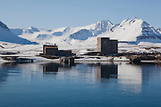 Old coal grading buildings and old power station, Ny Alesund, Svalbard. The coal mine, and the settlement were abandonded in 1963, after the Kings Bay Affair - 71 people were killed in accidents in the coal mines in between 1945 and 1963, and the Norwegian government resigned following an investigation. 21 people died in the 1962 accident. The mine closed down, and was later supplanted by the scientific research basis that exists today. Note coffin painted on the wall to mark the deaths.