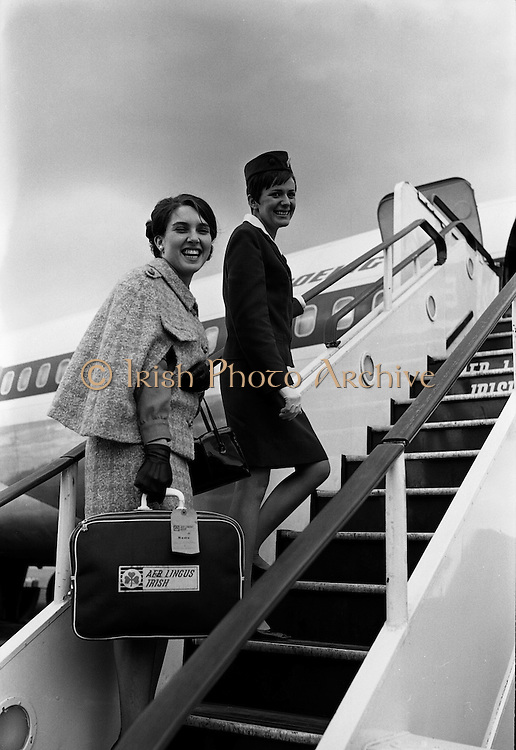 Ann Foley, Rose of Tralee 1967, leaves for a tour of the US. By coincidence, the Aer Lingus hostess pictured with her, Rosaleen Kelleher, was the Dublin Rose in that year's competition.  .11.10.1967
