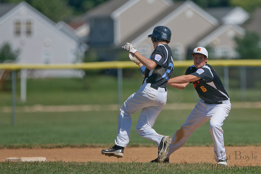 Maryland's Brian Delaney tags out Pennsylvania's Matt Klimas on a steal attempt during the finals of the Eastern Regional Senior League tournament between Pennsylvania and Maryland held in West Deptford on Thursday, August 11.