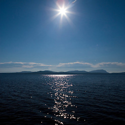 "Sunlight sparkles on Moosehead Lake in Maine's Northern Forest.  View Southeast from ""Big W."""
