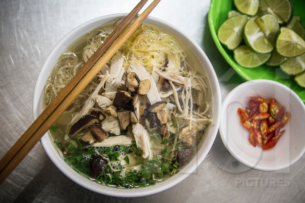 Bowl of traditional vietnamese dish bun thang, a vermicelli soup with shredded chicken. Hanoi, Vietnam, Southeast Asia