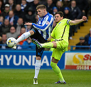 Gary Hooper of Sheffield Wednesday and Gordon Greer of Brighton and Hove Albion during the Sky Bet Championship Playoff Semi Final First Leg at Hillsborough, Sheffield<br /> Picture by Richard Land/Focus Images Ltd +44 7713 507003<br /> 13/05/2016