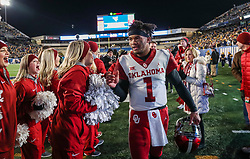 Nov 23, 2018; Morgantown, WV, USA; Oklahoma Sooners quarterback Kyler Murray (1) celebrates with fans after beating the West Virginia Mountaineers at Mountaineer Field at Milan Puskar Stadium. Mandatory Credit: Ben Queen-USA TODAY Sports