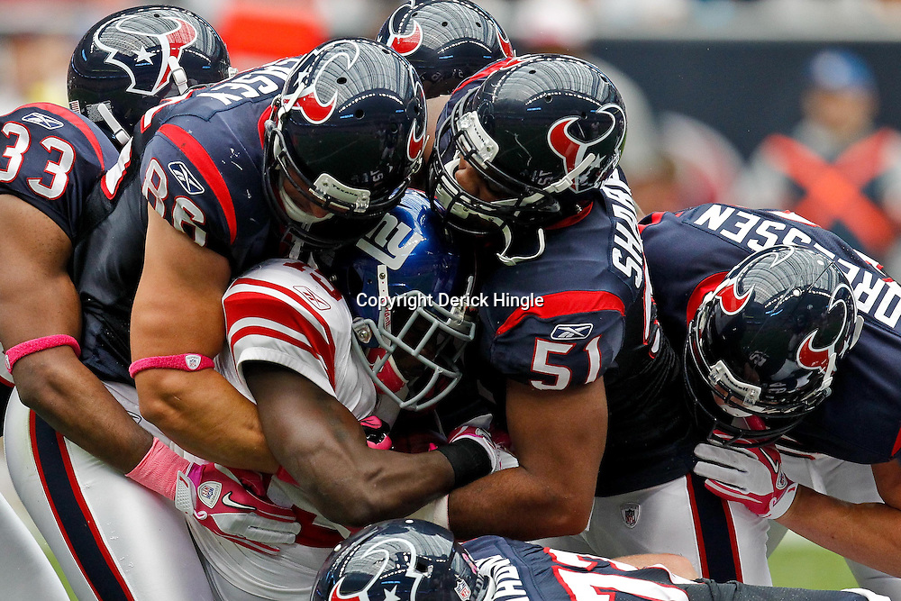 October 10, 2010; Houston, TX USA; New York Giants running back Darius Reynaud (15) is tackled by Houston Texans defenders during the first half at Reliant Stadium. Mandatory Credit: Derick E. Hingle